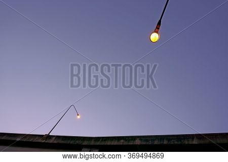 Two Pole Light On The Super Highway Under Dark Blue Sky In Evening Background, Worm Eyes View Photo
