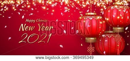 Chinese New Year Red Background With Chinese Lanterns. Hanging Silk Lanterns, Flying Petals And Glit