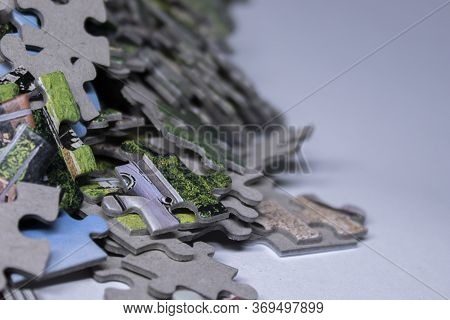 Multicoloured Puzzles On A White Background. Isolated. Top View, Copy Space.