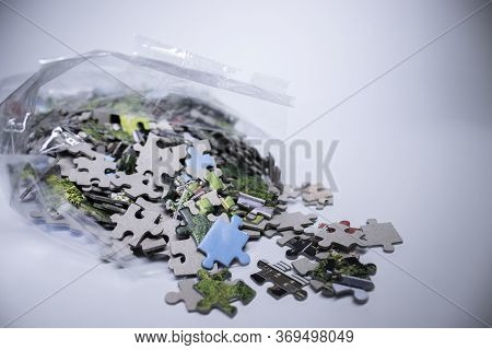 Packing With Multicoloured Puzzles On A White Background. Isolated