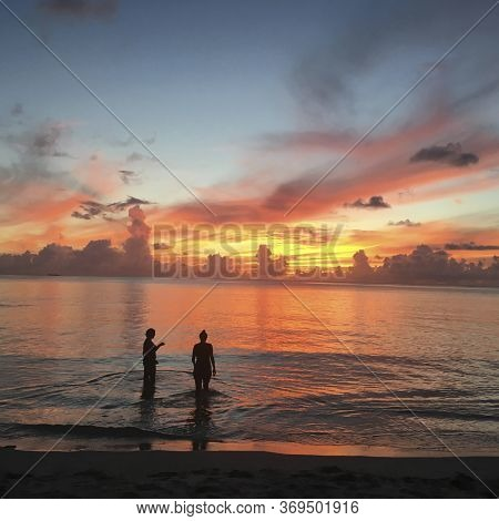 Red Romantic Unforgettable Sunset On A Tropical Island Saipan, Pink Sky, Calm Water Of The Philippin