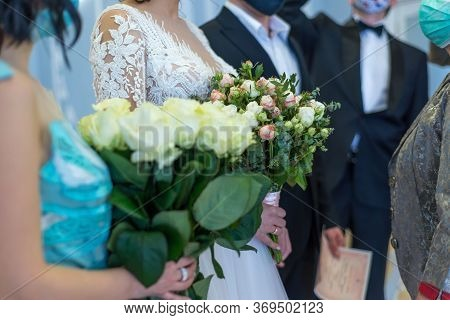 Close-up Relatives, Friends And Acquaintances Congratulate The Newlyweds On Their Wedding Day. The B