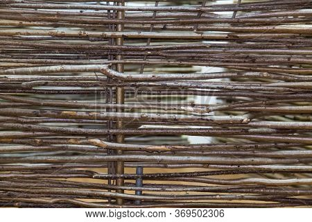Background Fence Of Vines Woven From The Branches Of The Vine Trees. Backgrounds, Structures, Design