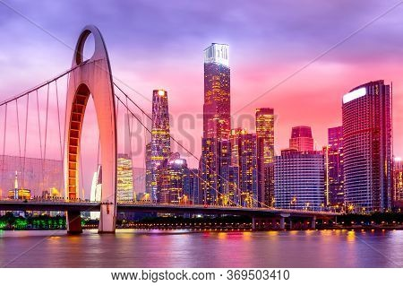 Guangzhou Cityscape Over Pearl River With Liede Bridge And Illuminated Financial District During Bea