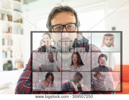 Businessman online talking with colleagues on screen