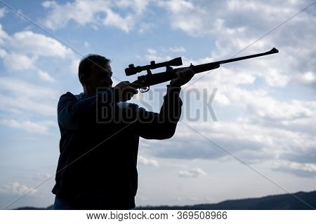Man with rifle and sniper silhouette
