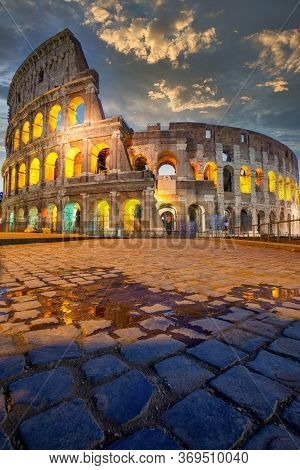 Night View Of Colosseum In Rome, Italy. Rome Architecture And Landmark. Rome Colosseum Is One Of The