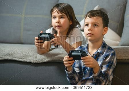 Kids Playing Console Games Durring Covid 19 Outbreak