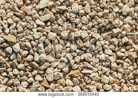 Macadam Of Limestone For Road Surface Close Up, Crushed Limestone Aggregate.
