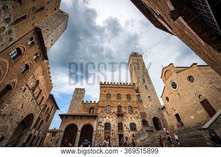 San Gimignano, Tuscany, Italy - July 12, 2014: Piazza Del Duomo (cathedral Square) In San Gimignano