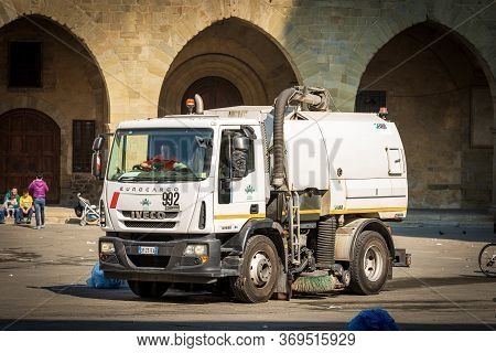 Pistoia, Tuscany, Italy - March 26th, 2016: A Street Sweeper Machine Cleans The Square After A Stree