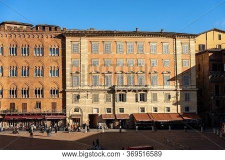 Siena, Tuscany, Italy - Jan 6, 2017: Ancient Palaces (palazzo Sansedoni And Chigi Zondadari) In Piaz
