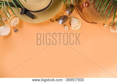 Trendy Summer Flat-lay With Female Fashion Outfit - Straw Hat, Bamboo Bag, Sunglasses, On Peach Back
