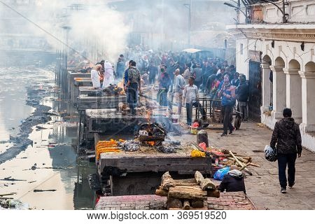 Kathmandu,nepal - February 12,2018: Hindu People Cremating Dead Bodies According To Hindu Rituals At