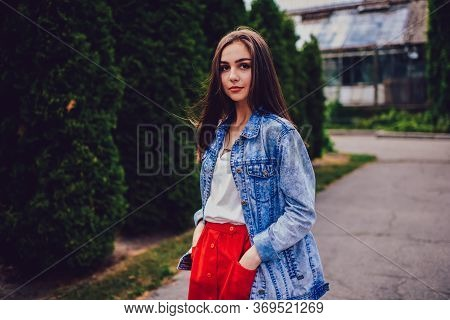 Gorgeous Female Dressed In Jacket Strolling On Street.portrait Of Young Woman In Trendy Clothing