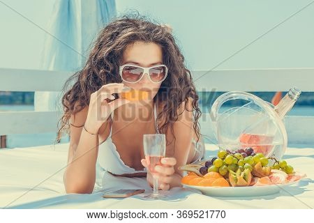 Closeup Young Beautiful Woman Smiling Happy Holding Champagne Glass, Eating Orange Celebrating Anniv