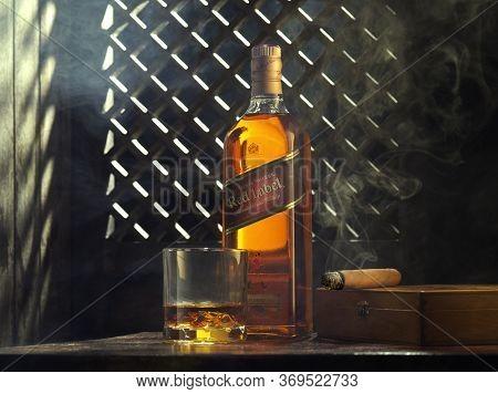 Phuket, Thailand- 01 April 2020. Johnnie Walker Red Label Blended Whisky Isolated On Color  Backgrou