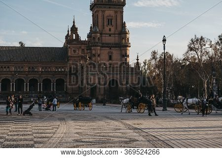 Seville, Spain - January 17, 2020: City Tour Horse-drawn Carriages On Plaza De Espana, A Plaza In Th