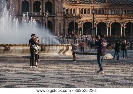 Seville, Spain - January 17, 2020: People Taking Photos In Front Of Fountain On Plaza De Espana, A P