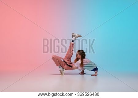 Beautiful Sportive Girl Dancing Hip-hop In Stylish Clothes On Colorful Gradient Background At Dance