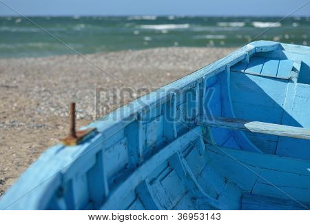 Blue Boat On The Beach