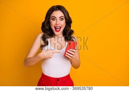 Photo Of Pretty Crazy Lady Open Mouth Hold Telephone Directing Finger Screen Smart Phone Device Sale