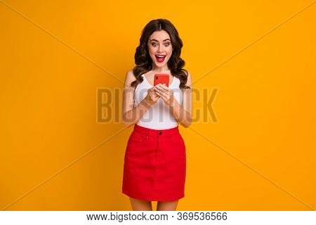 Photo Of Funky Millennial Lady Open Mouth Hold Telephone Read Positive Blog Post Comments Wear Casua
