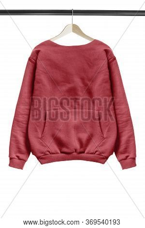 Red Oversized Sweatshirt Hanging On Wooden Clothes Rack Isolated Over White