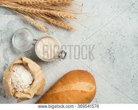 Wheat Sourdough Starter. Top View Of Bread Making Ingredients - Glass Jar With Sourdough Starter, Fl