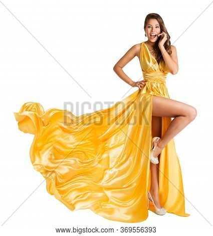 Woman Yellow Dress Flying On Wind, Beautiful Fashion Model In Fluttering Gown On White Background