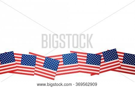 Miniature flags of the United States of America arranged to form a wave