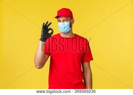 Express Delivery During Pandemic, Covid-19, Safe Shipping, Shopping Concept. Courier In Red Uniform