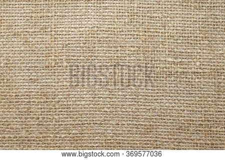 Natural Linen Raw Uncolored Textured Sacking Burlap Background. Hessian Sackcloth Canvas Woven Textu