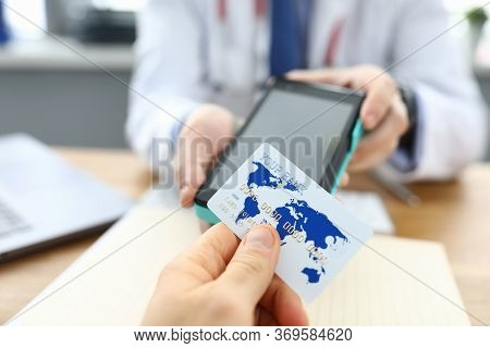 Patient Clinic Is Calculated By Doctor Credit Card. Effectiveness Health Care. Patient Receives Trea