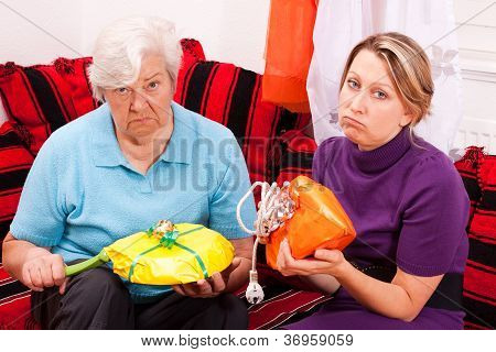 Old And Young Woman Getting Loveless Gifts