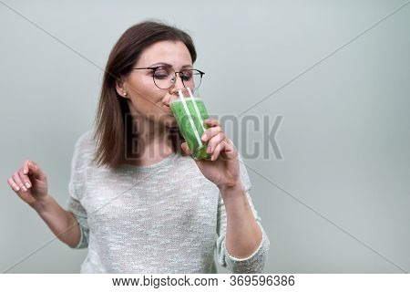 Mature Woman With Green Vegetable Smoothie Drink, Healthy Vegan Diet, Woman Drinking Juice, Copy Spa