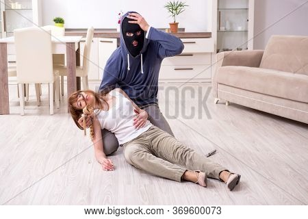 Gangster and young woman in robbery concept