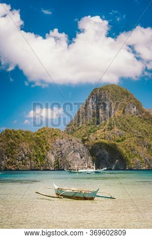 Boat In El Nido Bay And Cadlao Island In Background, Palawan, Philippines