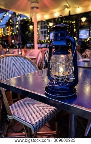 Magical Light From A Traditional Lantern On A Restaurant Table In Copenhagen. Christmas Lights And D