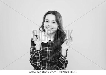 Just Happy. Small Girl Classy Checkered Dress. Child Long Curly Hair. Happy Schoolgirl Stylish Unifo