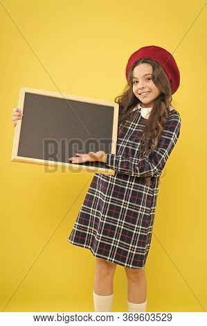 Glad To Inform You. Happy Child With Promo Board. Place For Ad Or Announcement. Girl With Smile Hold