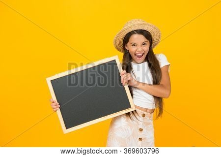 Happy Child Presenting Blackboard. Back To School. Our School Is Out For Summer. Time For Traveling.