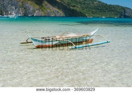 Boat On Blue Shallow Ocean Water. El Nido Bay, Palawan, Philippines