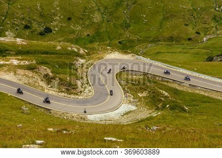 Bikers Going Down The Beautiful Serpentines Of The  Transalpina Road In Romania - The Highest Mounta