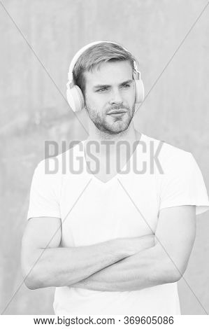 Comfortable Ergonomic Design. Modern Guy Wear Headphones Grey Background. Handsome Man Listen To Mod