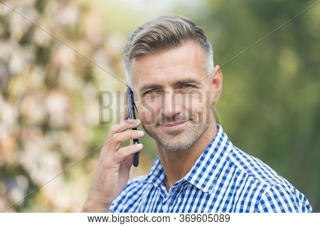 Answering A Call. Unshaven Man Talk On Cell Phone Outdoors. Taking Cell Phone Call. Mobile Or Cell P