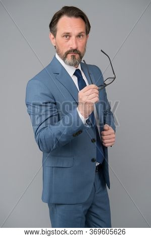 Fashion Portrait Of Man. Bearded Man After Hairdresser. Portrait Of Mature Man Wearing Glasses. Adul