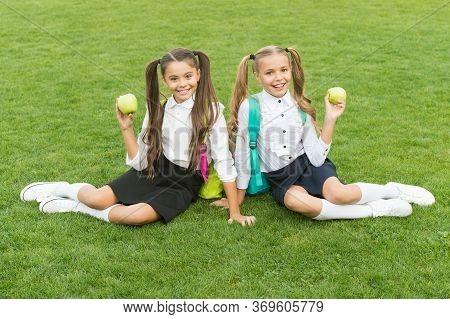 Enjoying Snack Break. Happy Girls Eat Apples On Green Grass. Taking Vitamin Snack. School Snack. Hea