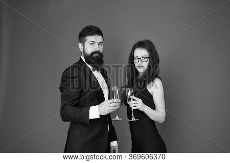 Occasion To Celebrate. Couple In Love Drink Sparkling Wine. Attractive Woman Bearded Man Raise Glass
