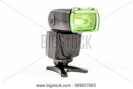 Oblique View Of A Black Unbranded External Flash Unit For Dslr Camera With Cooling Diffuser Applied
